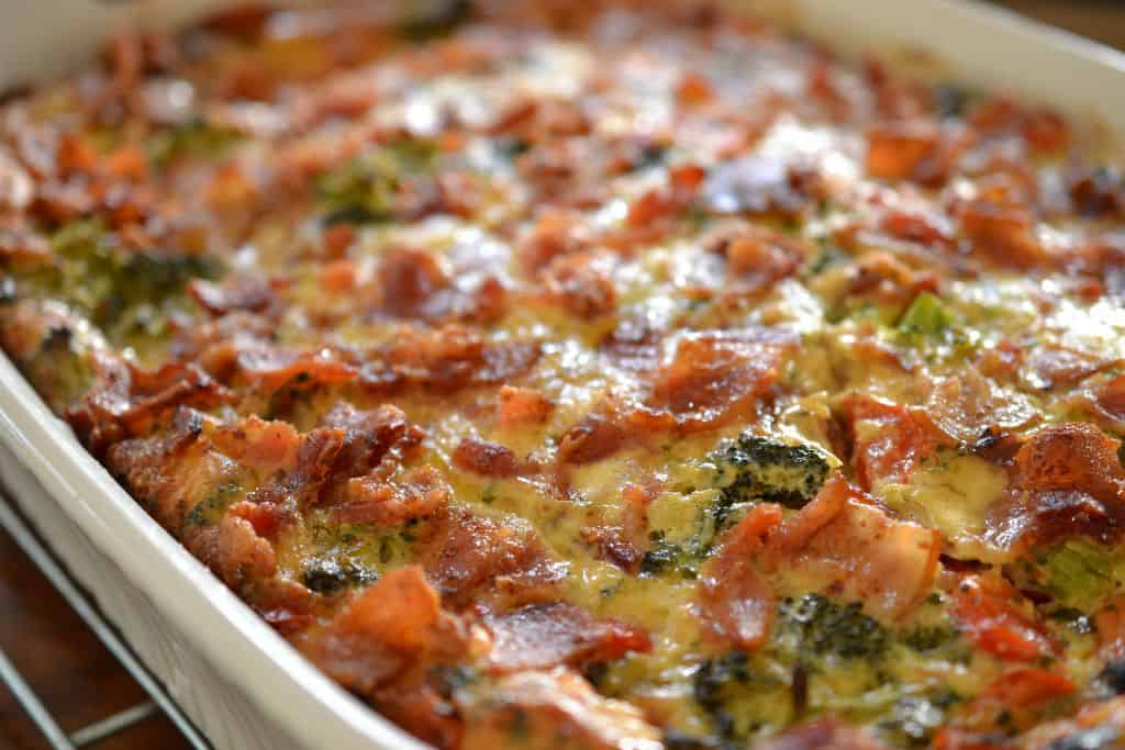Crispy bacon, creamy cheese and tender veggies make this overnight egg casserole a perfect breakfast
