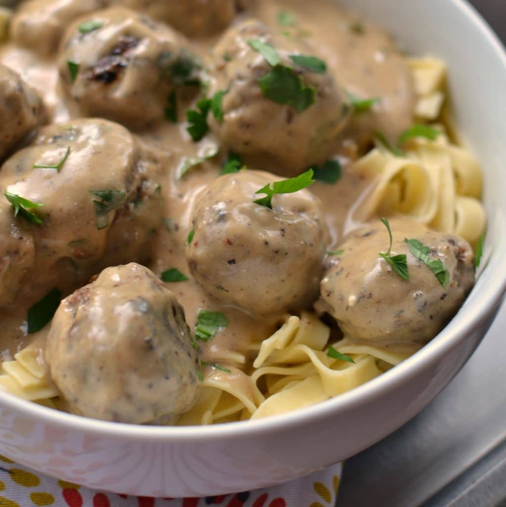 Mix gravy and sour cream in large saucepan. Add meatballs; stir to evenly coat. Cook on low heat 5 min. or until sauce is heated through, stirring occasionally.