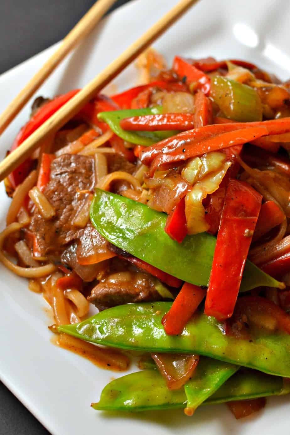 This Beef Lo Mein combines beef, onions, peppers, carrots, snow peas and noodles in a slightly spicy ginger soy sauce.