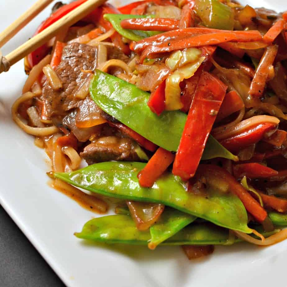 A delectably easy Beef Lo Mein stir fry recipe with onions, carrots, celery, red bell pepper, noodles and a savory sauce.