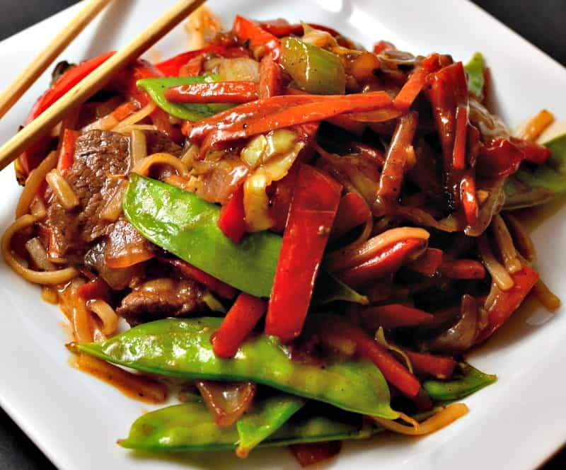 This Beef Lo Mein combines tender beef, onions, peppers, carrots, snow peas and rice noodles in a ginger soy sauce.