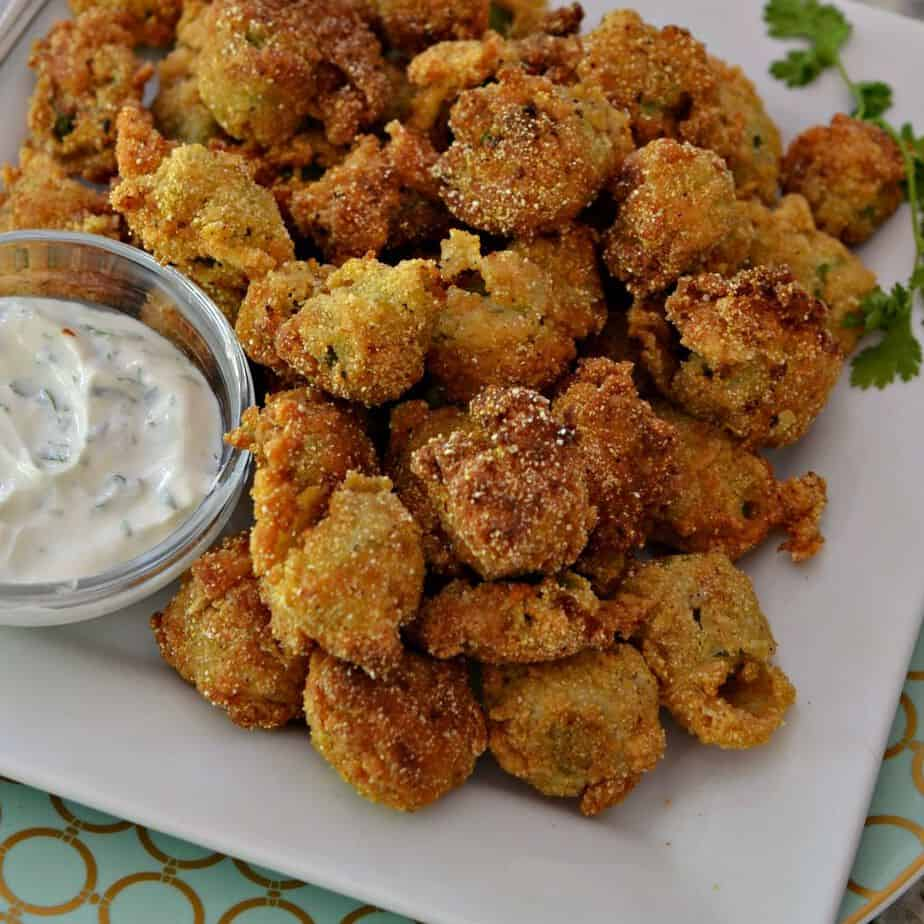 This crispy southern fried okra is a delicious appetizer served with a creamy jalapeno yogurt sauce.