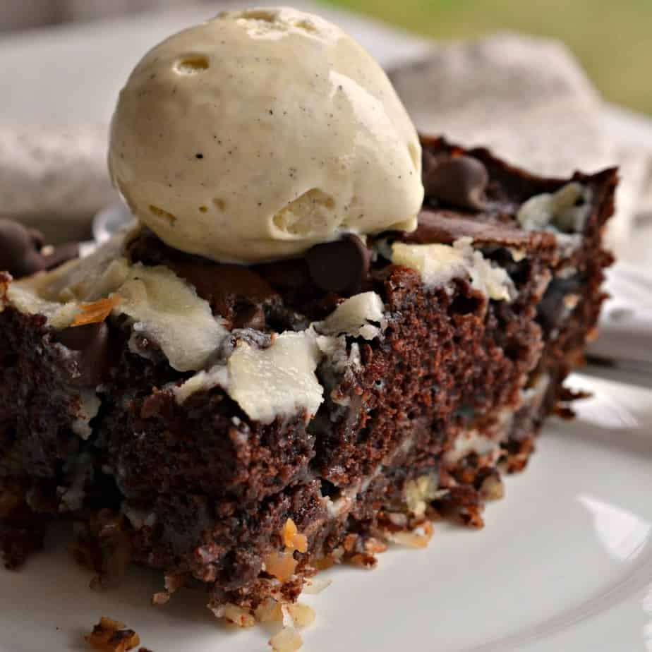 Earthquake Cake is an ooey gooey scrumptiously moist chocolate cake with pockets of cream cheese, pecans and coconut.