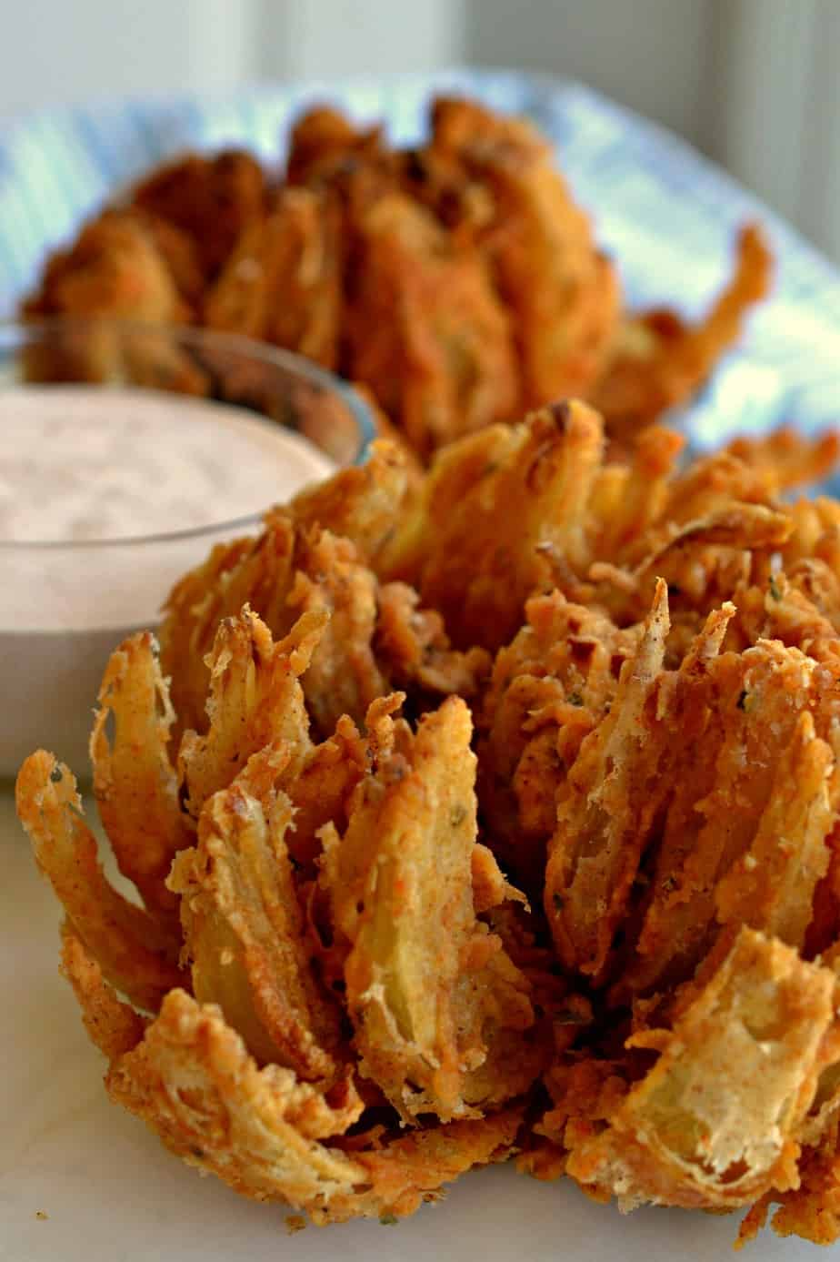 Make a delicious blooming onion for your family today and don't forget the tasty dipping sauce.