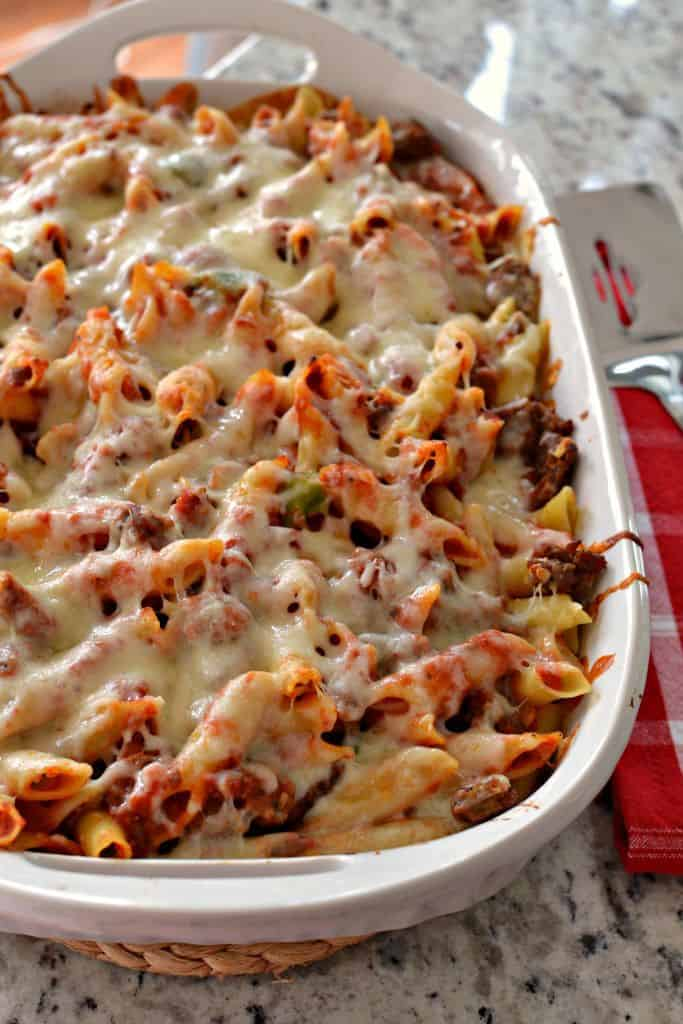 Baked Mostaccioli combines Italian sausage, peppers, onions and marinara all blanketed in mozzarella and provolone cheese.
