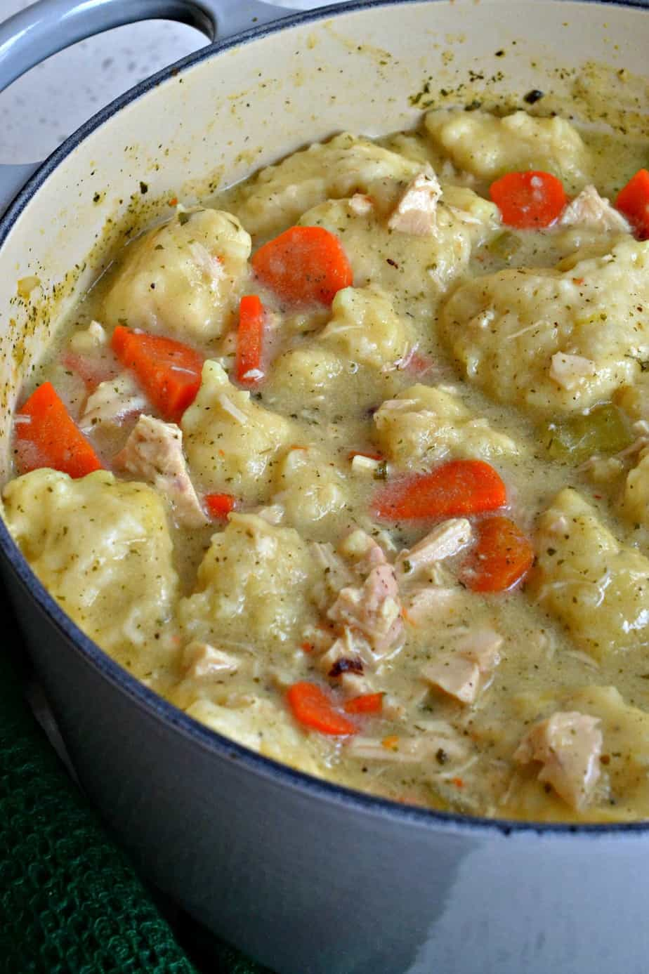 This Chicken and Dumpling Soup recipe is made with creamy broth, succulent chicken, sweet carrots and light fluffy dumplings.