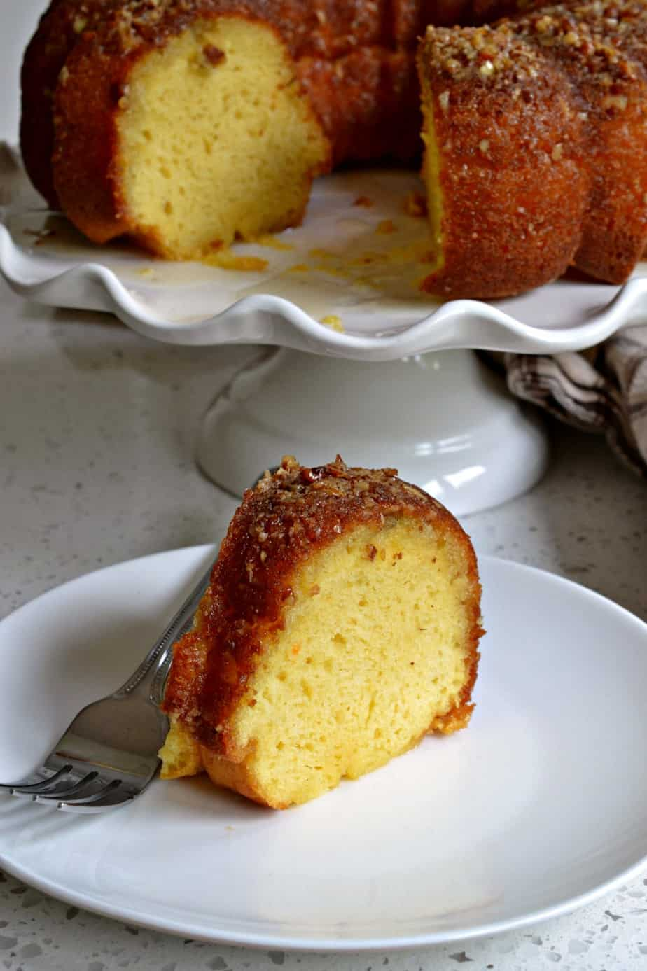 A moist easy Rum Cake with a butter rum glaze that comes together quickly using a yellow butter cake mix