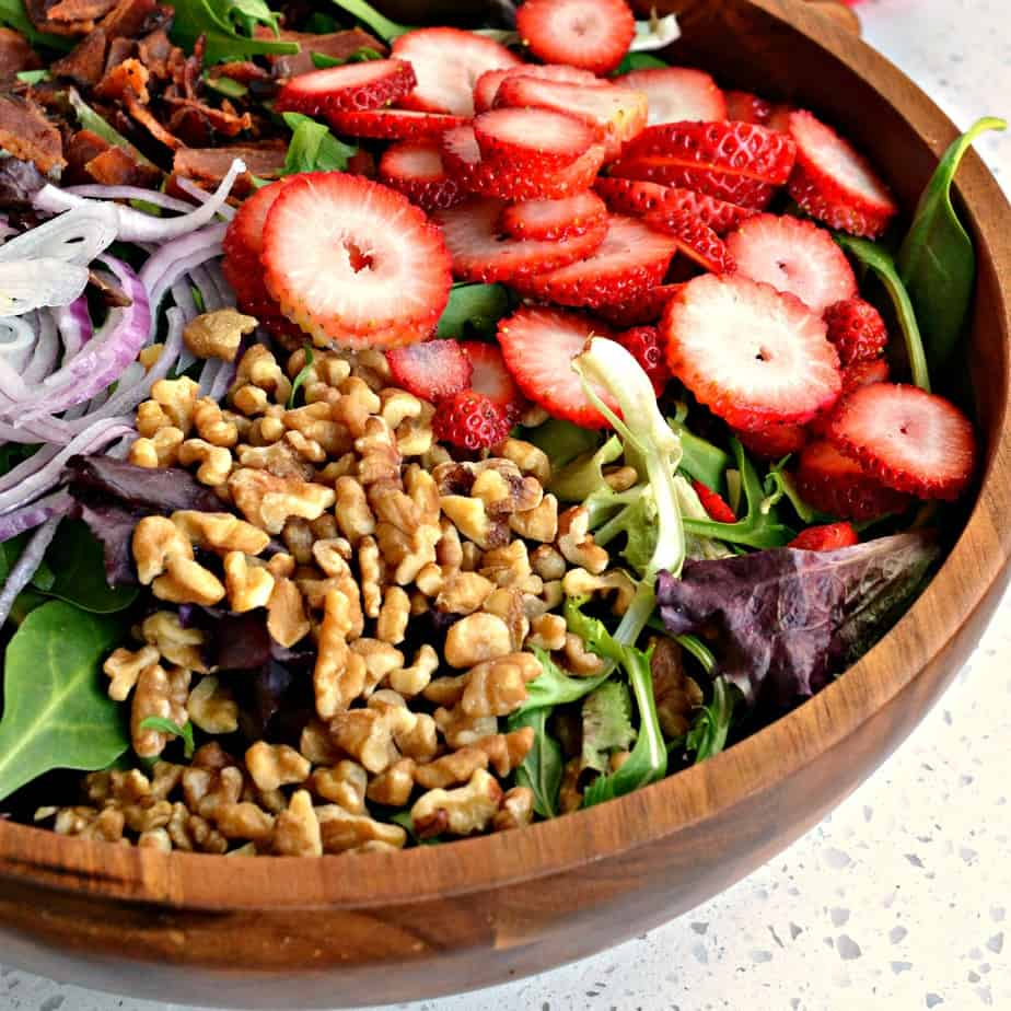 Sweet and crunchy Strawberry Spinach Salad with poppy seed dressing combines fresh strawberries, red onions, feta, crisp walnuts and smoked bacon.