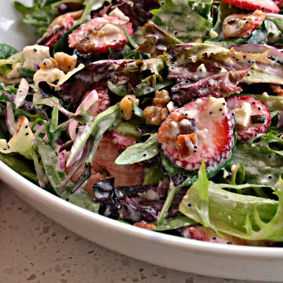 Sweet and crunchy Strawberry Spinach Salad with poppy seed dressing is the perfect spring and summer salad.