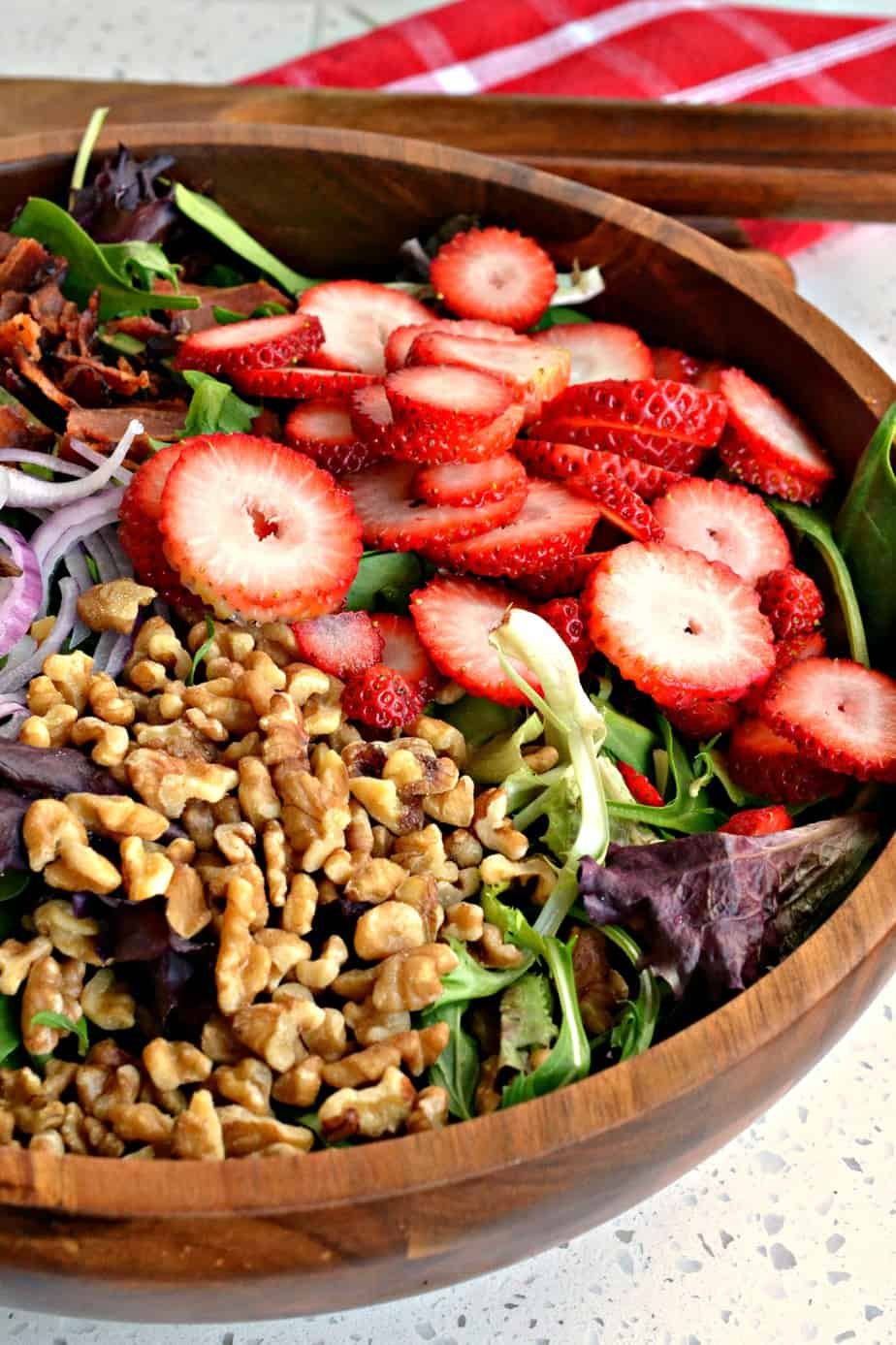 This Strawberry Spinach Salad with bacon and walnuts is always a hit for spring and summer gatherings.