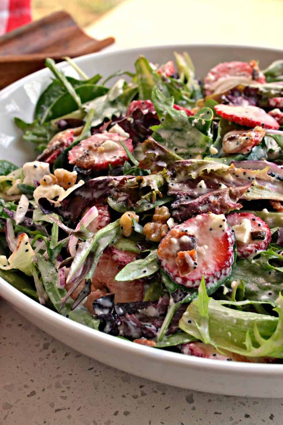 This Strawberry Spinach Salad with homemade poppy seed dressing is always a hit for spring and summer gatherings.