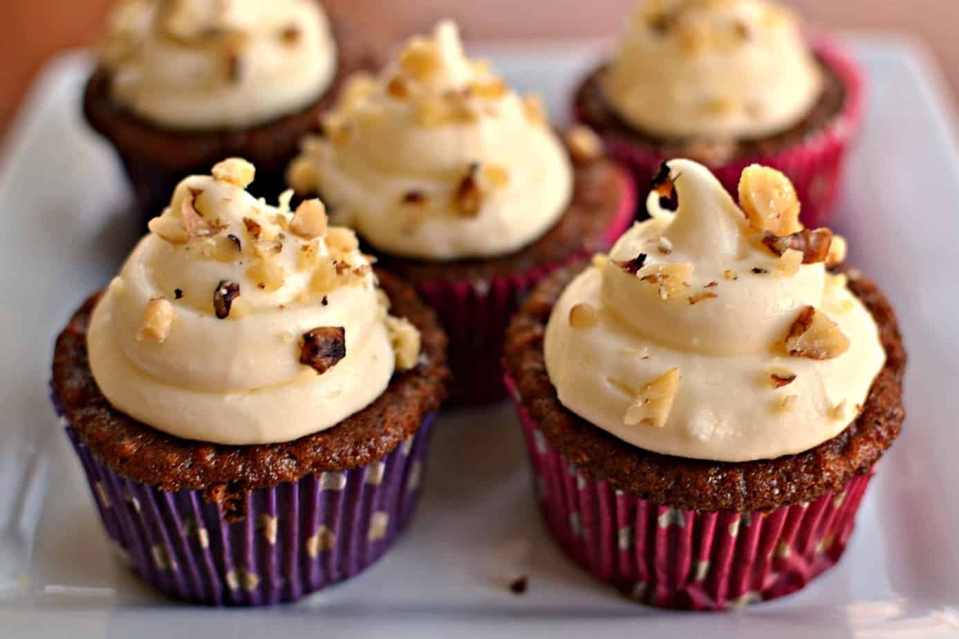These delectable Carrot Cake Cupcakes with crushed pineapple and walnuts are topped with a creamy cream cheese frosting.