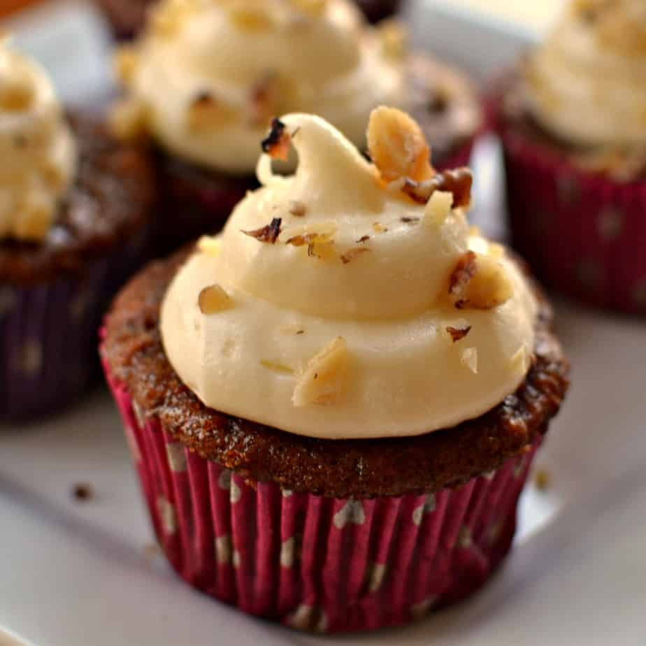 Carrot cake cupcakes are topped with a delectable four ingredient white chocolate cream cheese frosting.