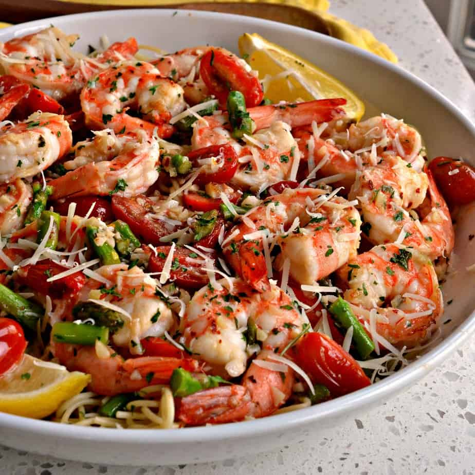 Shrimp Scampi is traditionally served over angel hair pasta or thin spaghetti.