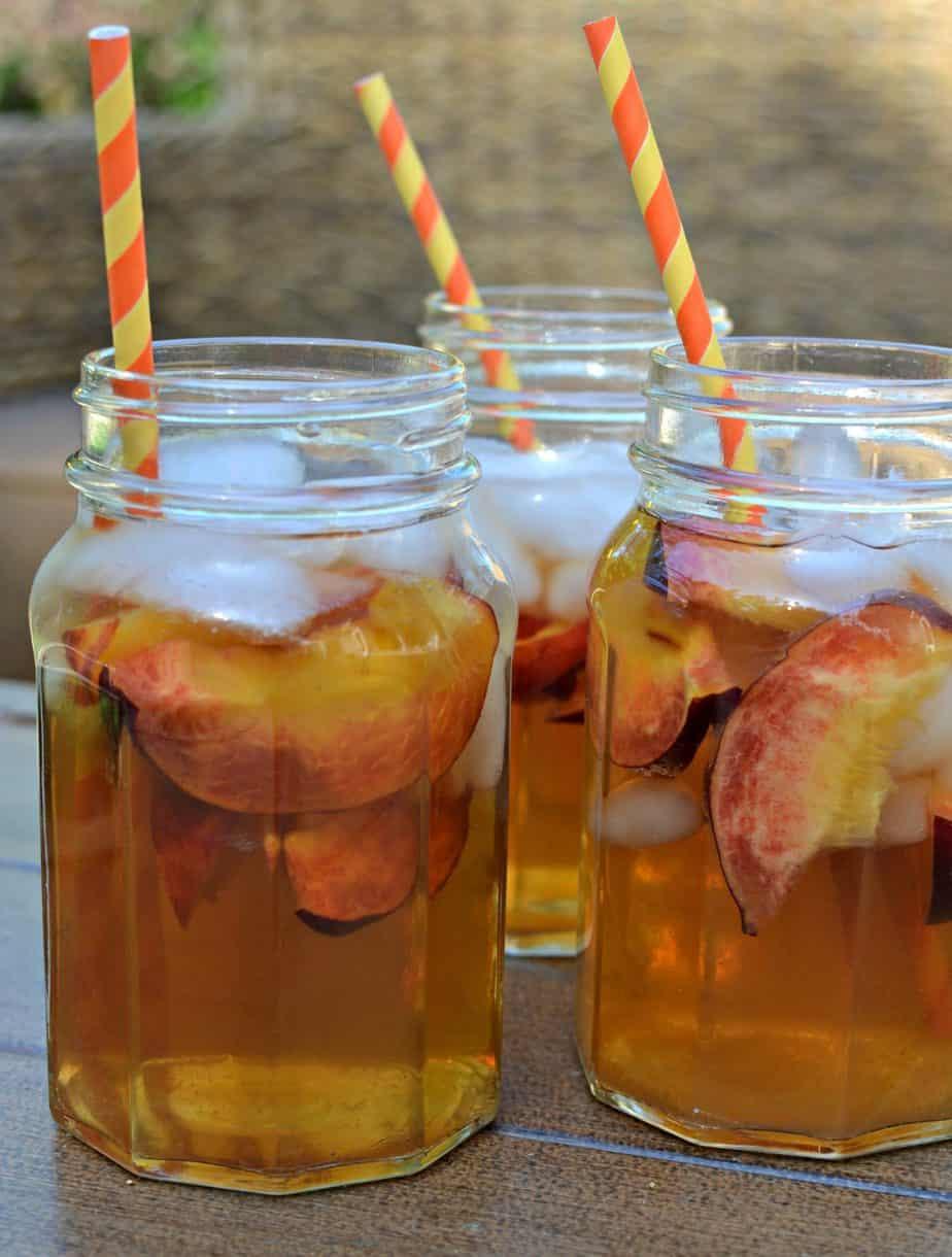 A cool refreshing homemade peach tea made with fresh simmered peaches and tea bags.