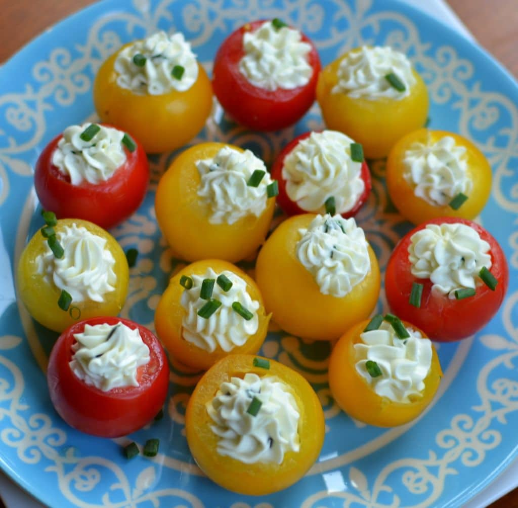 Sweet herb cream cheese and juicy cherry tomatoes make this simple appetizer a party favorite