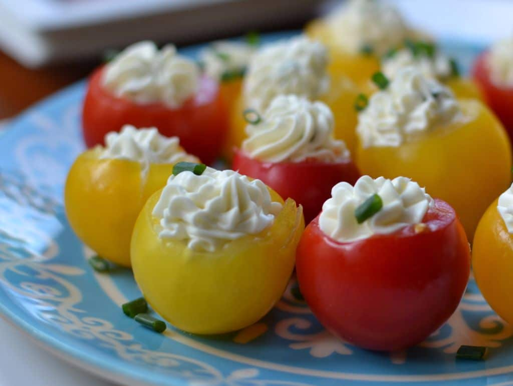 Herb Cream Cheese Stuffed Cherry Tomatoes are a simple, delicious appetizer that will go fast at any party