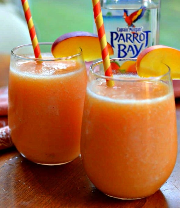 These cool and refreshing Peach Daiquiris are made with four easy ingredients int the blender in less than five minutes.