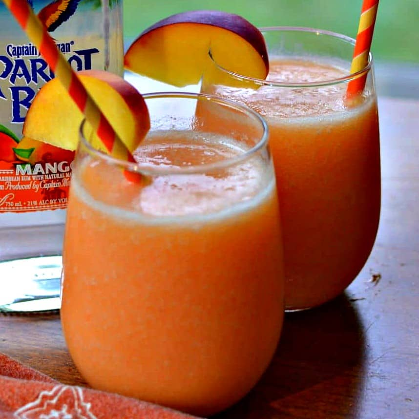 These deliciously refreshing Peach Daiquiris are made with four easy ingredients int the blender in less than five minutes.