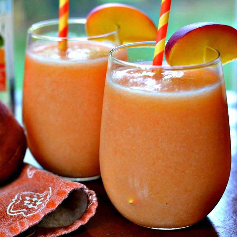 These delectable quick and easy fresh Peach Daiquiris will become your favorite refreshing summer cocktail.
