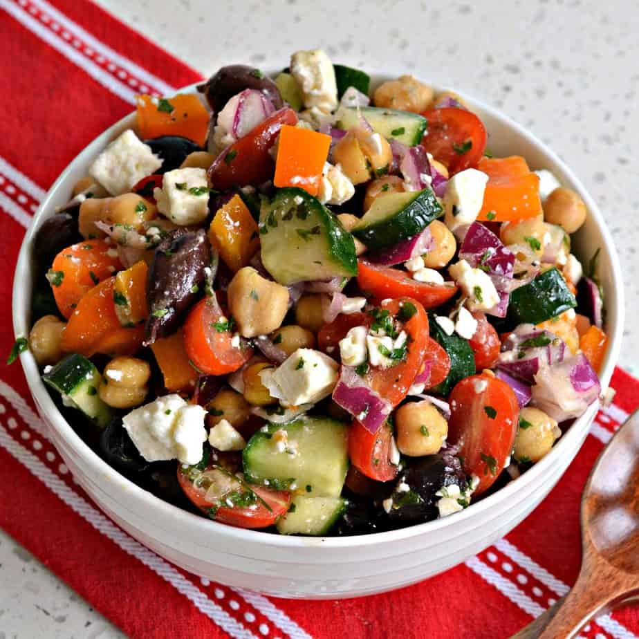 An easy Mediterranean Salad made with chickpeas, cucumbers, onions, bell peppers and feta cheese with a lemon vinaigrette.