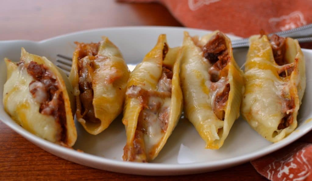 Creamy cheese and tangy BBQ pork make these stuffed shells a savory and delicious meal