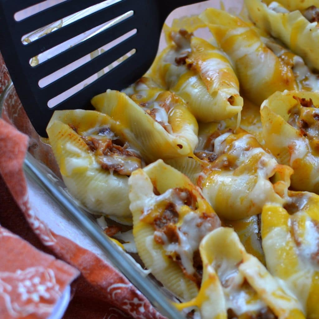 Tender pasta shells stuffed with BBQ pulled pork and triple cheese
