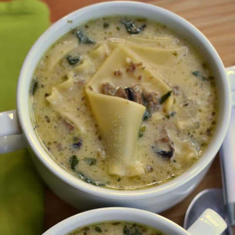 Creamy Alfredo Lasagna Soup is packed with mushrooms, spinach, and noodles all in a creamy parmesan broth