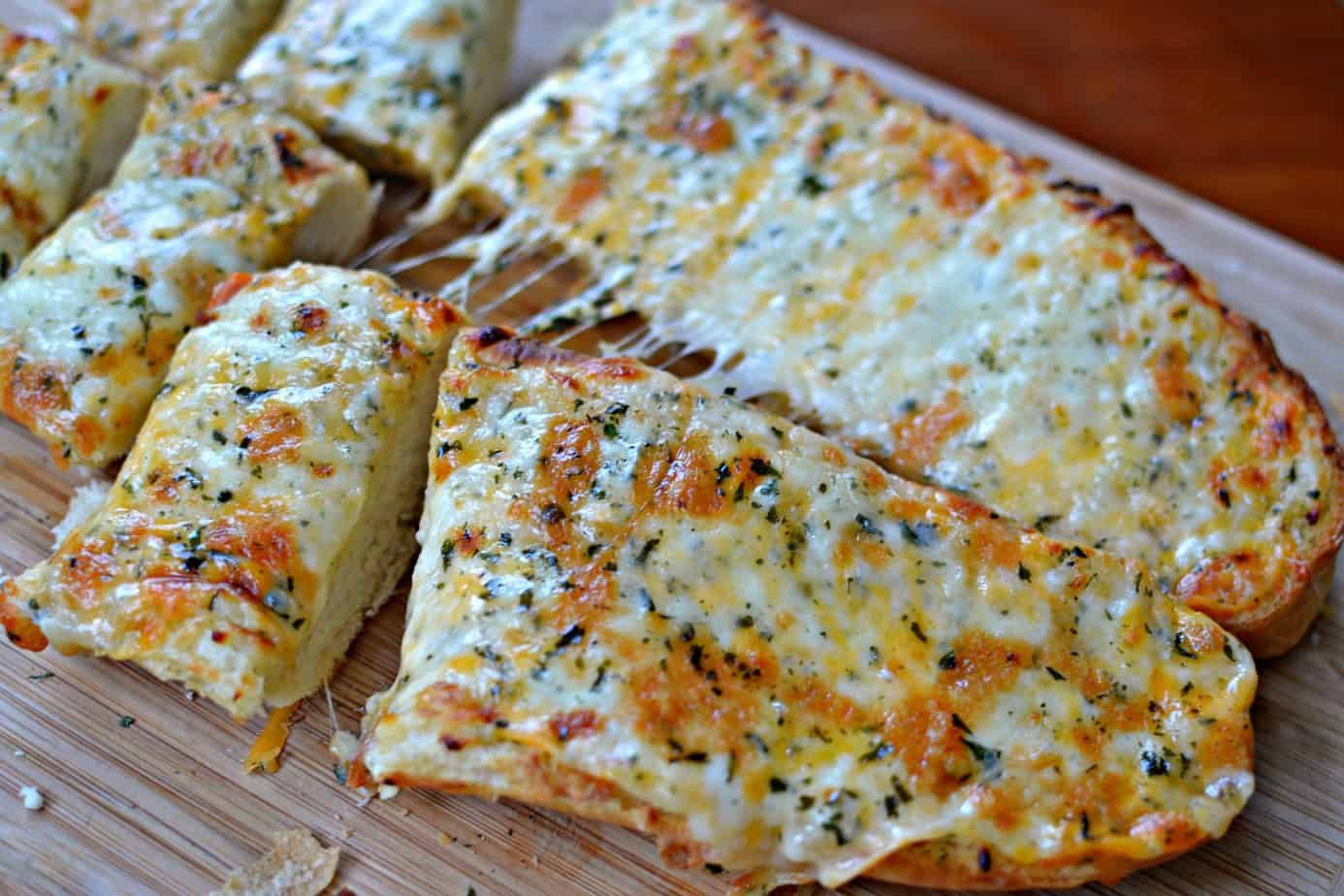 A easy to make loaf of French bread topped with garlic butter, mozzarella, cheddar, provolone and baked to perfection.