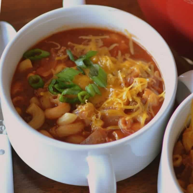 Topped with shredded cheddar cheese and chives, this beef and macaroni chili recipe is an easy one-pot dinner that's packed with flavor