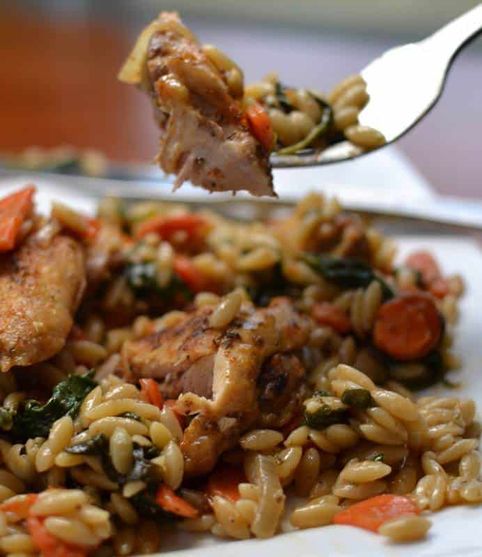 Tender orzo rice with crispy, juicy chicken thighs