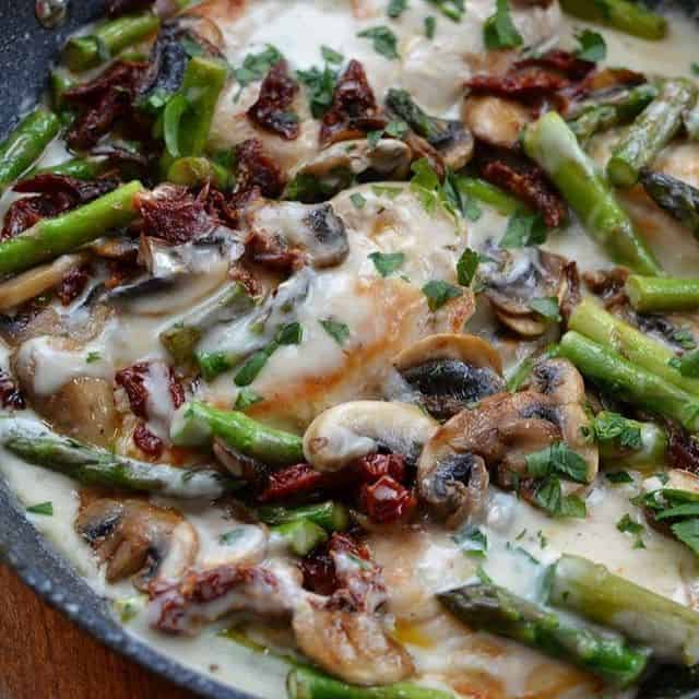 Easy Creamy Chicken Mushroom Asparagus Skillet Lightly browned chicken breastshellip