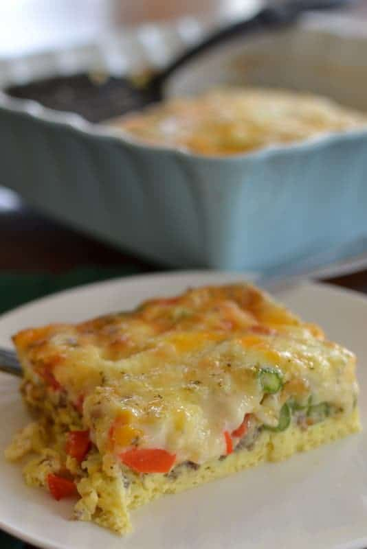 Light and fluffy eggs with cheese, red and green peppers, and asparagus