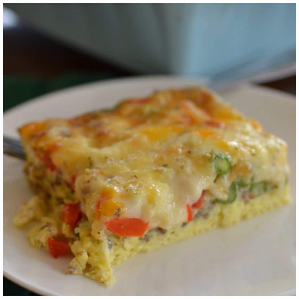 this cheesy breakfast casserole has red, green and yellow peppers and tender asparagus
