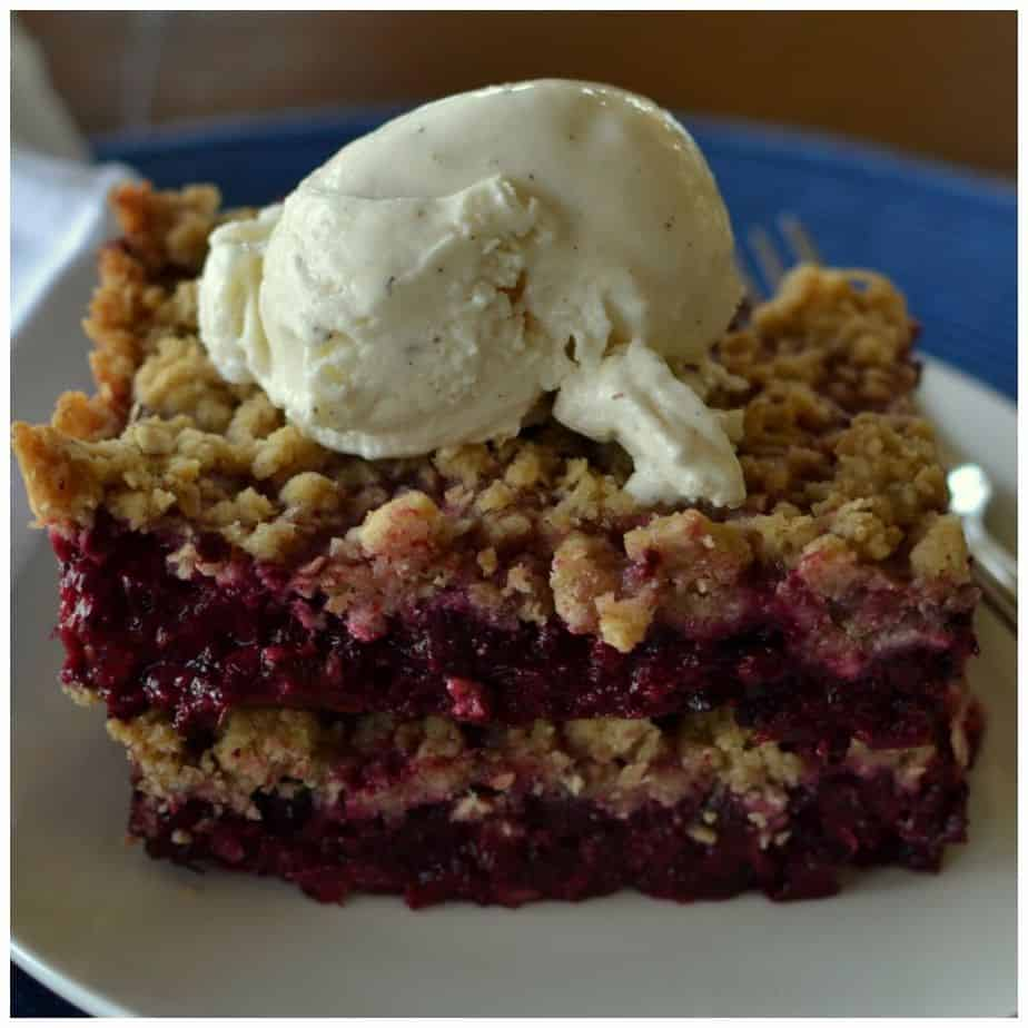 Crispy layers of topping and tart layers of blackberries, topped with sweet vanilla ice cream
