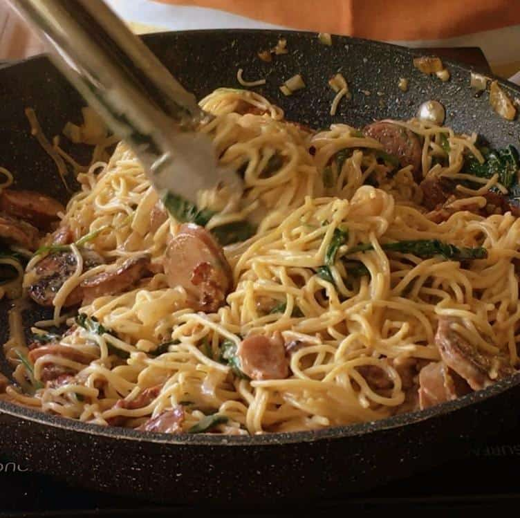 Creamy sun dried tomato and sausage pasta with bacon and spinach