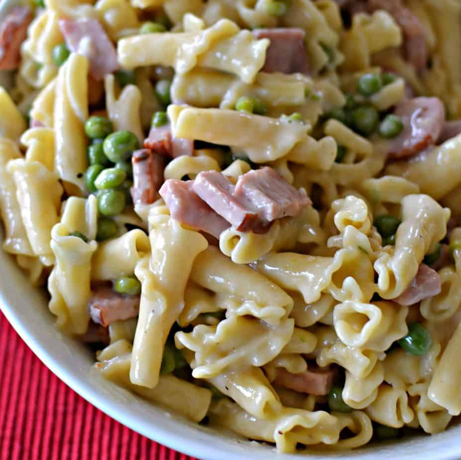 This Ham and Pea Campanelle combines smokey ham, sweet peas and pasta in a lightly seasoned super creamy cheese sauce.