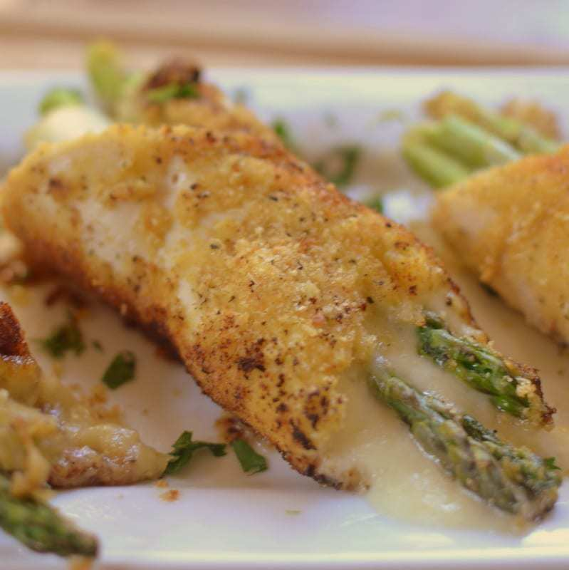 Breaded chicken breast stuffed with tender asparagus and parmesan cheese