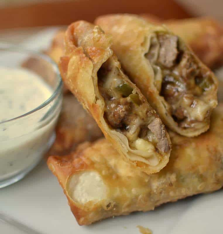 Steak, peppers and provolone cheese make these philly cheesesteak egg rolls a delicious party treat