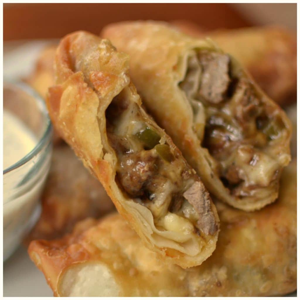 Homemade steak and cheese egg rolls have sweet green peppers and creamy provolone cheese.