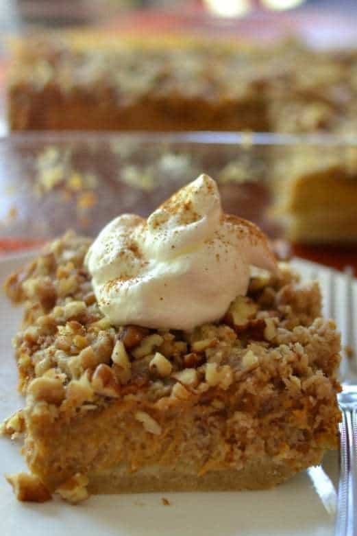 Crunchy Pecan Pumpkin Pie Bars are the perfect combination of the two most popular holiday pies - pumpkin and pecan!