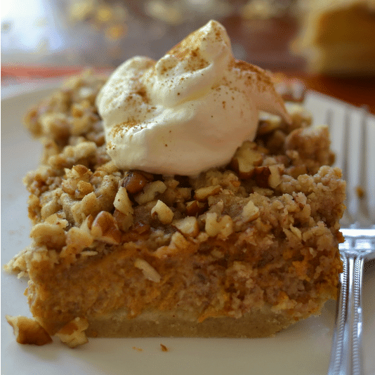 These pumpkin pecan pie bars are a heavenly slice of pumpkin pie with a sweet pecan topping