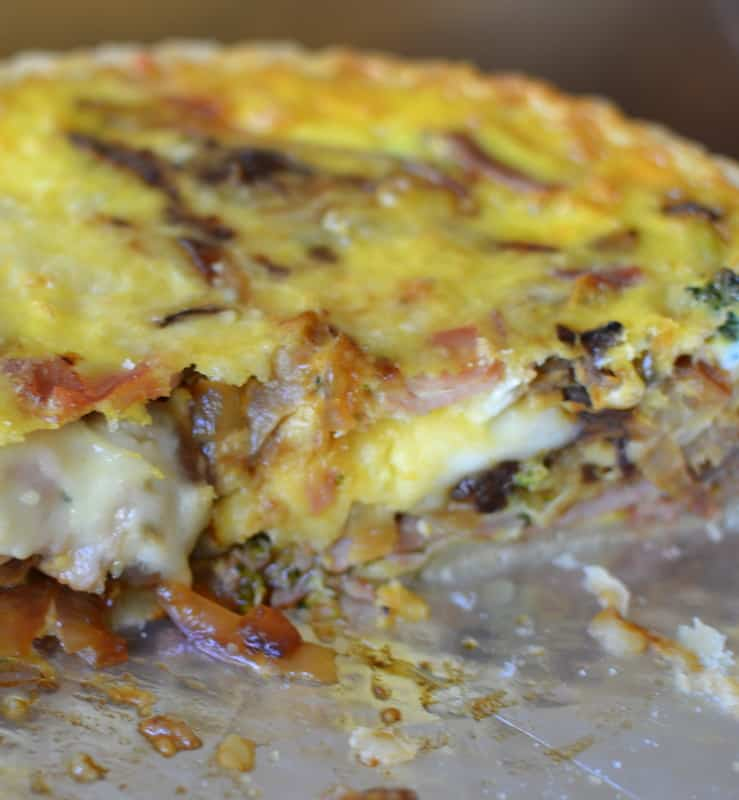 This creamy and savory breakfast quiche has caramelized onions, broccoli, ham, and creamy cheddar chese