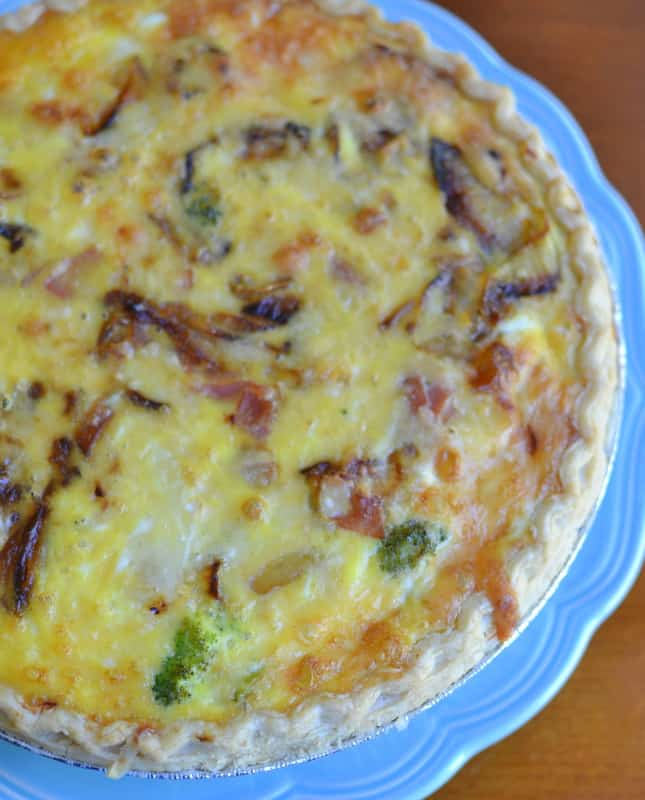 Make this savory ham and broccoli quiche with caramelized onions and cheddar cheese for a casual brunch gathering