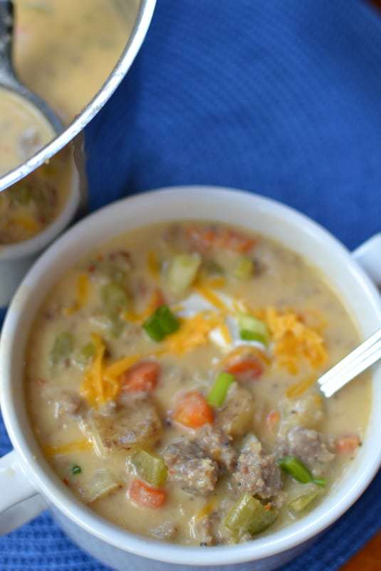 This creamy sausage and potato soup has spicy sausage, tender potatoes and veggies, all in a creamy, cheesy broth.