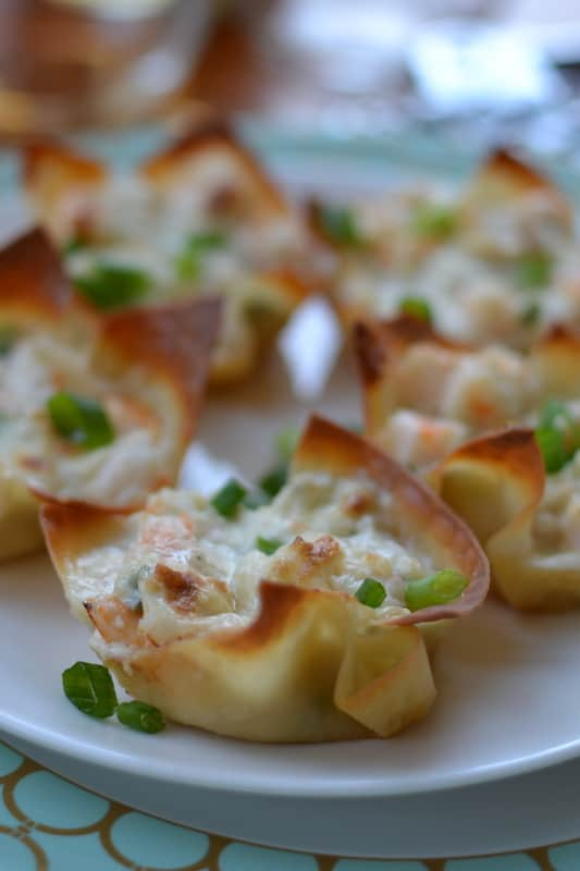 Baked wonton shells filled with triple cheese and shrimp dip