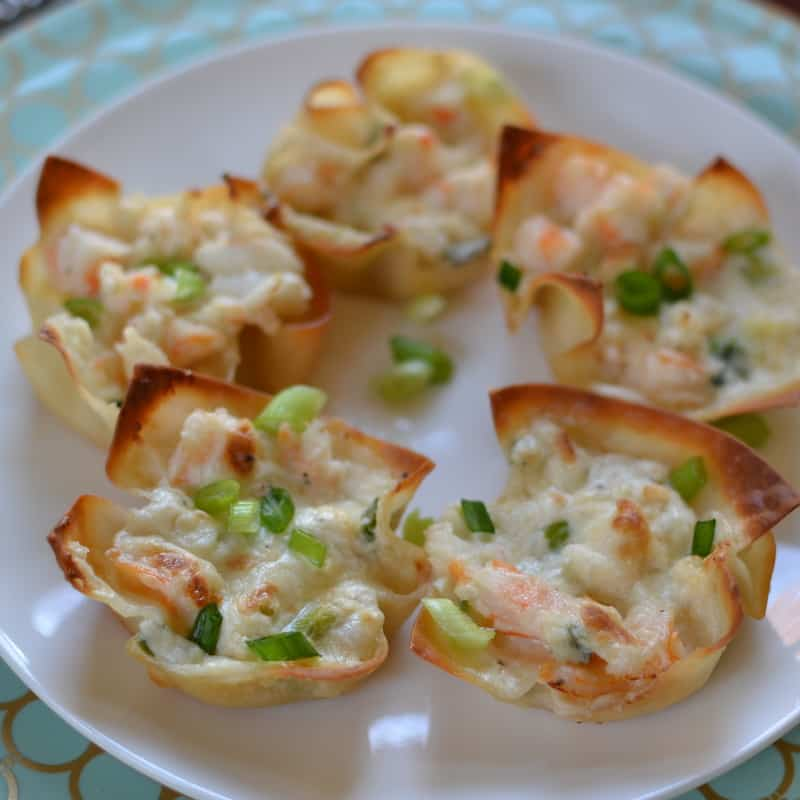 Triple cheese and shrimp dip baked in crispy wonton shells