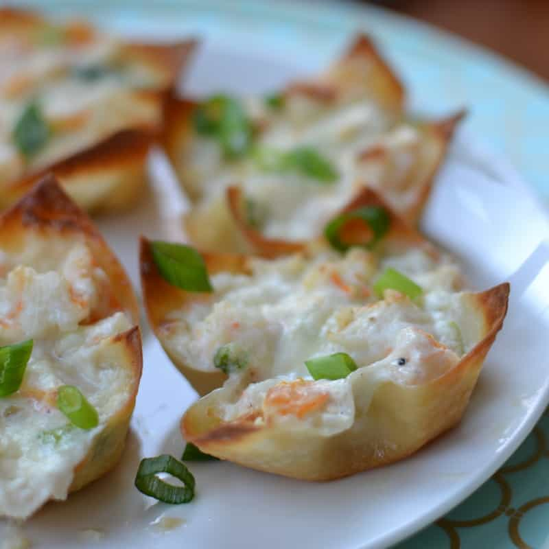 Cheesy shrimp dip baked in crispy wonton shells are a simple appetizer