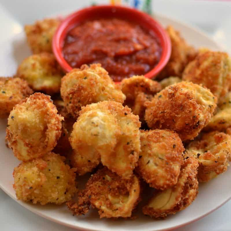 These crispy fried tortellini are sprinkled with Parmesan cheese and served with a hearty marinara