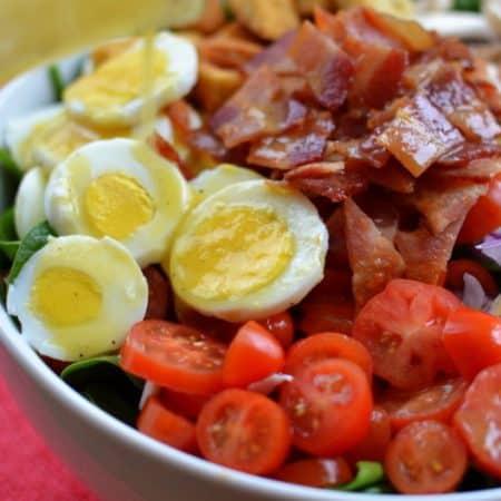 Spinach Salad with Warm Bacon Honey Mustard Vinaigrette